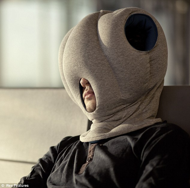 http://www.dailymail.co.uk/news/article-2208316/Ostrich-Pillow-Bizarre-invention-means-people-nap--wearing-pillow-balaclava.html